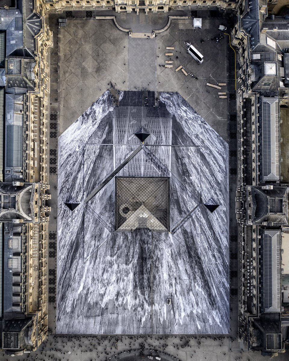 Artist JR Transforms the Louvre With a 2000-Piece Paper Optical Illusion