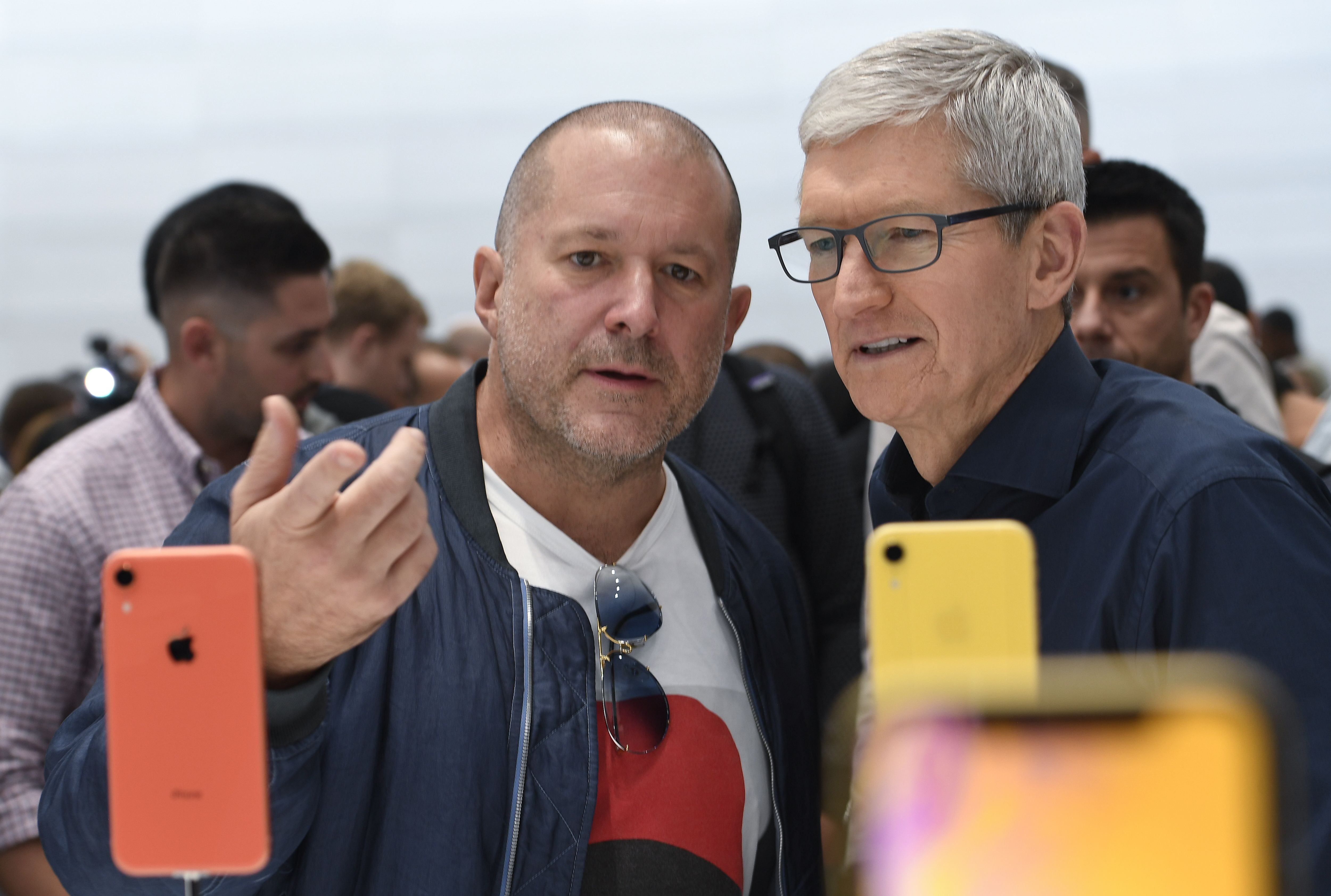 Apple chief design officer Jony Ive and Apple CEO Tim Cook inspect iPhone XR.