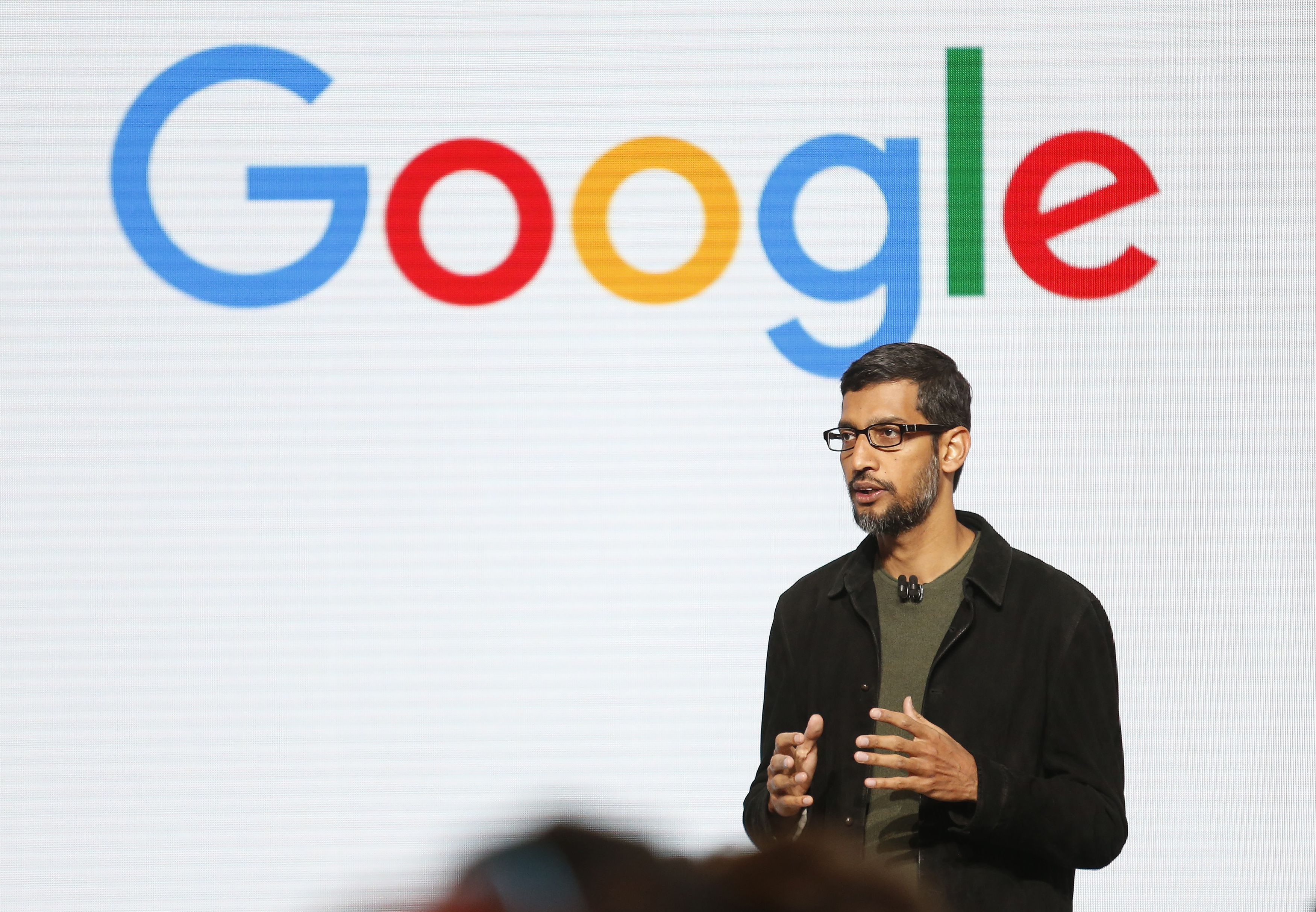 Alphabet closes down after reporting slowing Google ad revenue