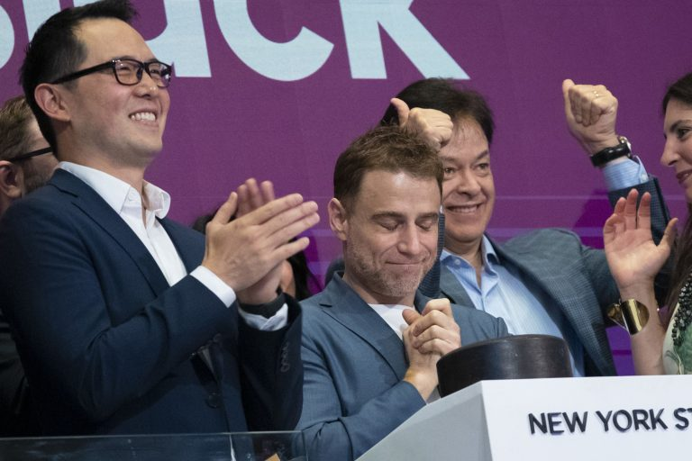 Stewart Butterfield, chief executive officer of Slack Technologies, Inc., speaks during an interview outside of the New York Stock Exchange (NYSE) during the company's initial public offering (IPO) in New York, U.S., on Thursday, June 20, 2019.