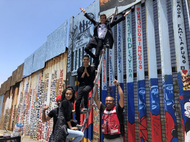 A Collaboratively Painted 'Mural of Brotherhood' Stretches for Over a Mile on Mexico's Border