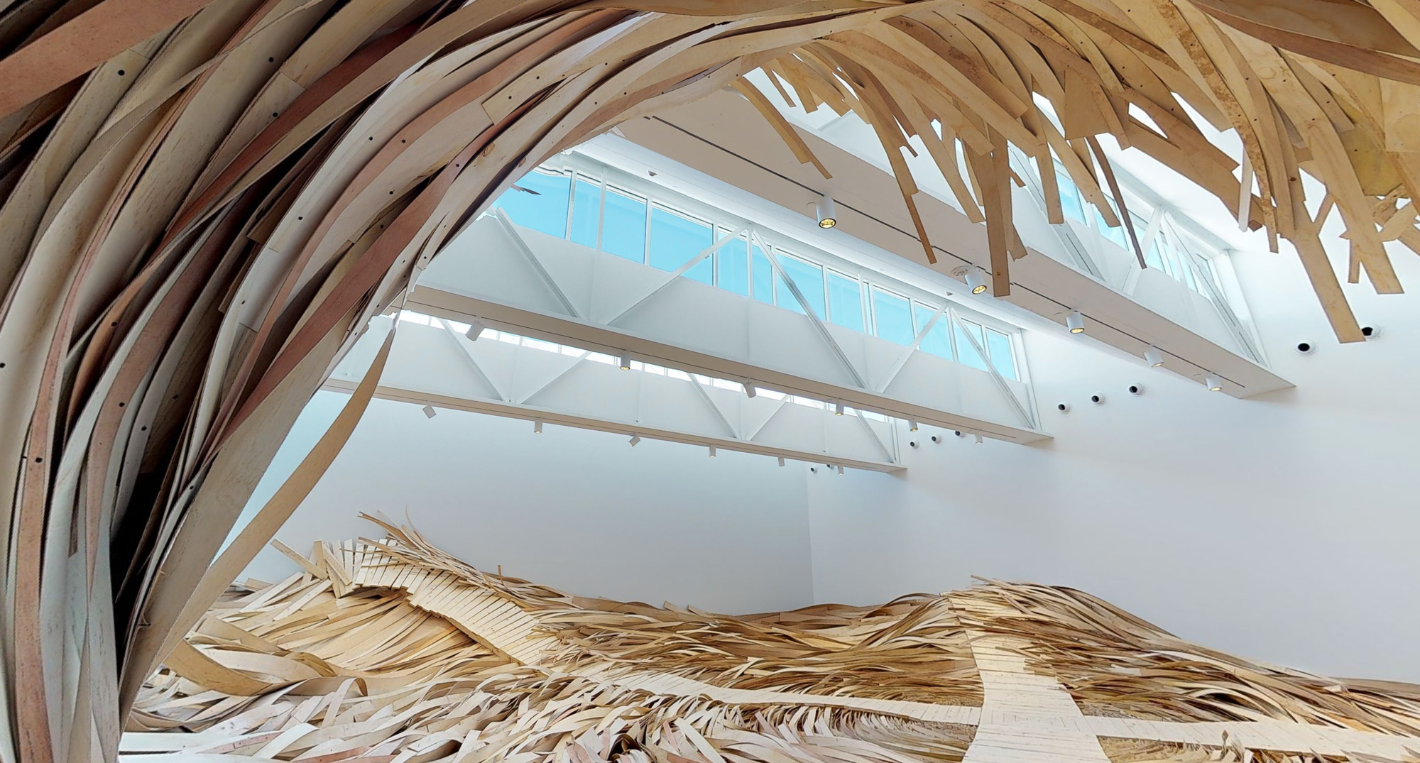 A Massive Wooden Wave Surges From a Gallery Floor in an Installation by Wade Kavanaugh and Stephen B. Nguyen