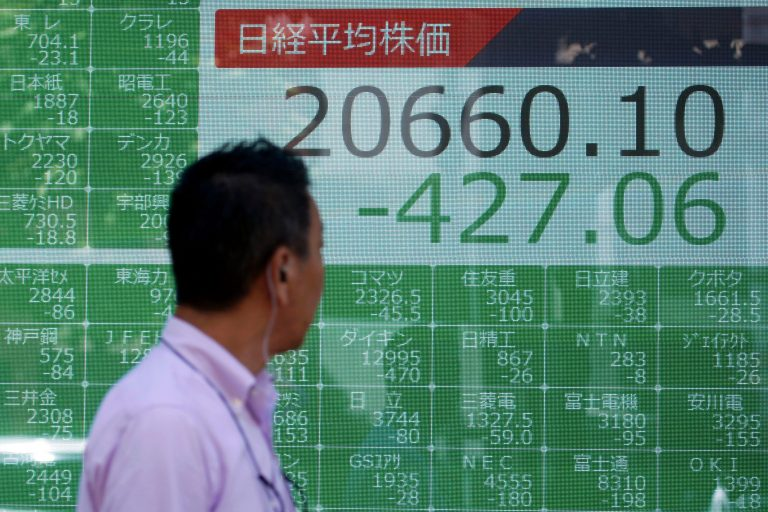 Stocks slump as yuan currency sinks