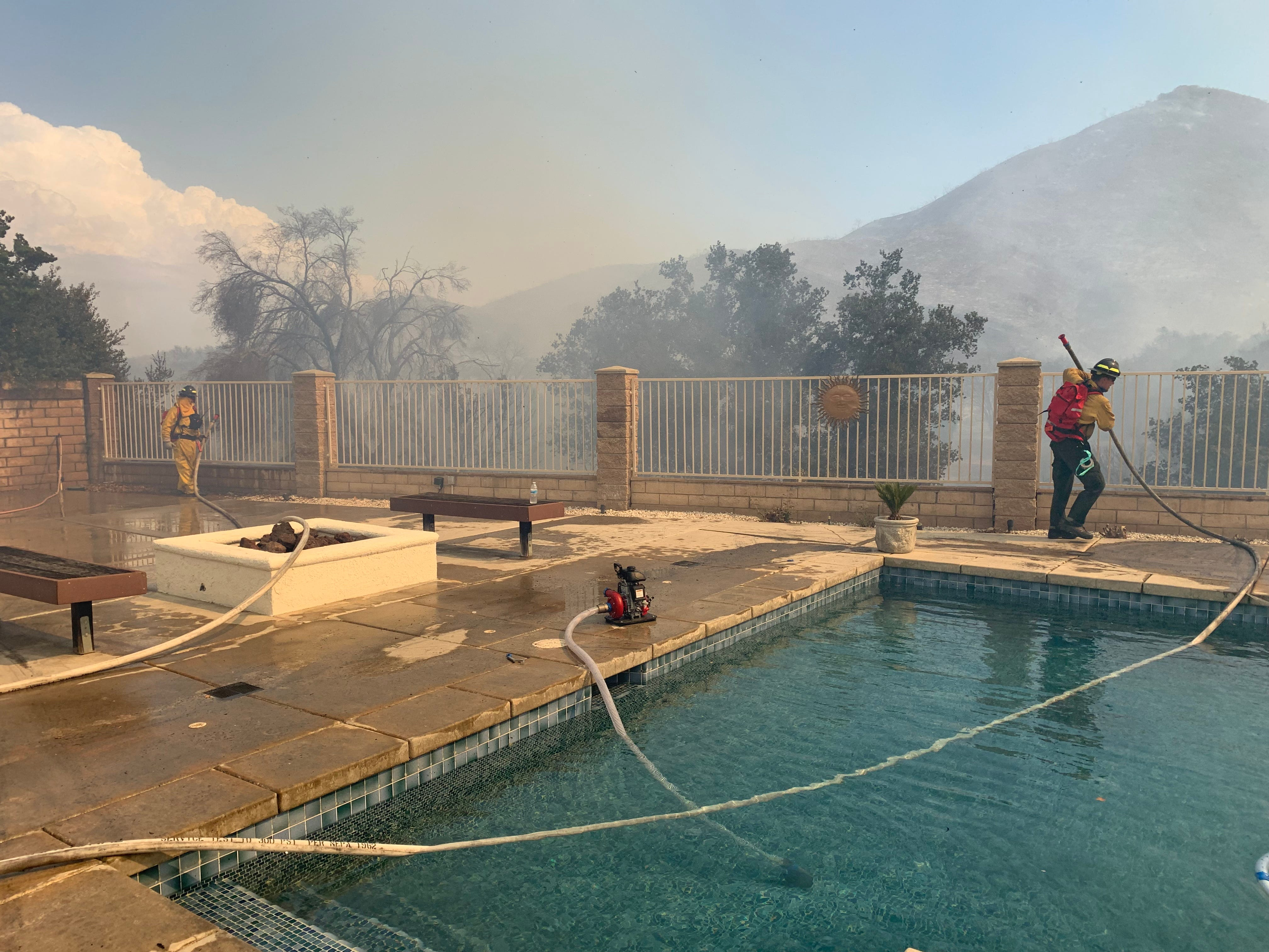 Private firefighters work to protect homes for insurers