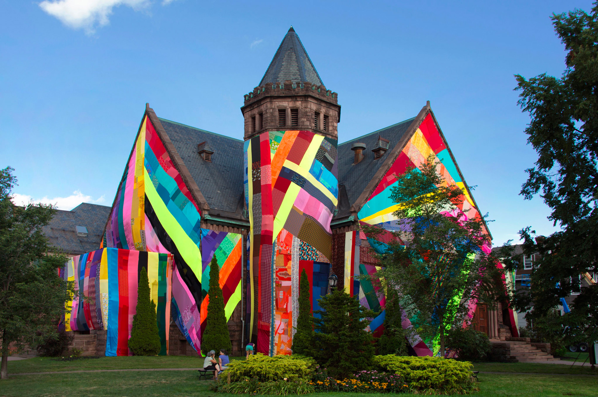Enormous Panels of Patchworked Fabric Give Colorful Temporary Makeovers to Public Buildings