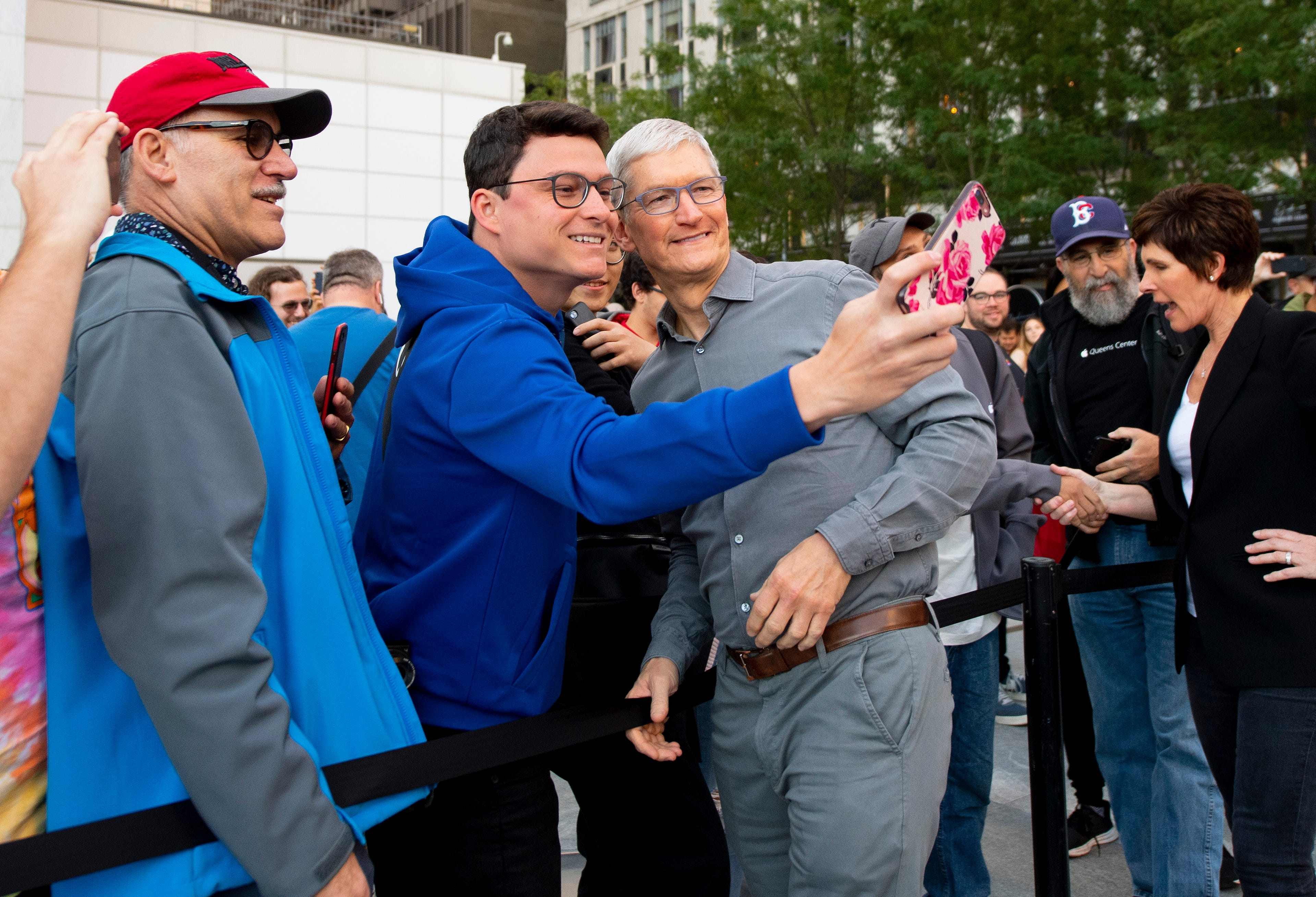 iPhone 11 goes on sale as Tim Cook greets early buyers at NYC store