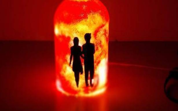 Spirited works of art and light: Table lamps created out of used liquor bottles
